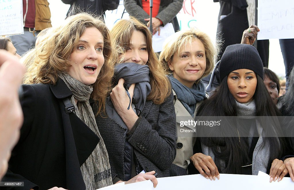Former UMP mayoral candidate in Paris Nathalie Kosciusko-Morizet, former French first lady Carla Bruni, French opposition party UMP's member of Parliament Valerie Pecresse, and French actress and author Saida Jawad take part in a demonstration for the release of the Nigerian schoolgirls held hostage by the Islamists in Nigeria, on May 13, 2014 on the Trocadero plaza in Paris, France.