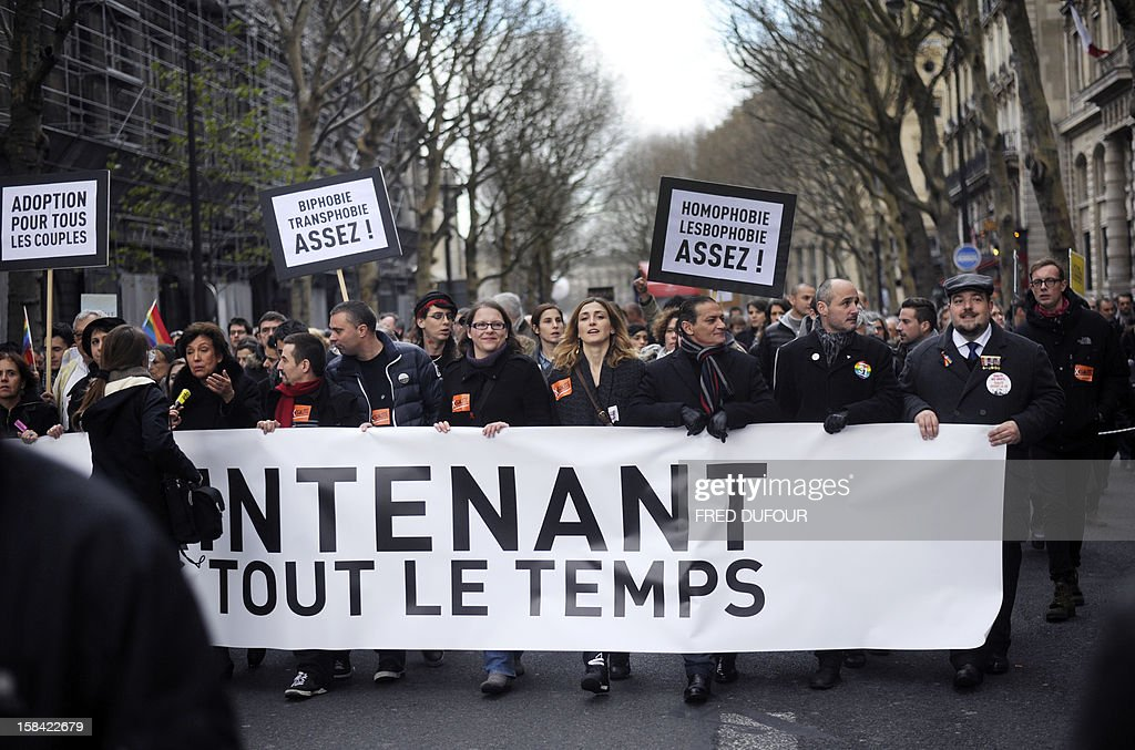 Former UMP right-wing party minister Roselyne Bachelot (L) answers to a journalist during a demonstration for the legalisation of gay marriage and LGBT (lesbian, gay, bisexual, and transgender) parenting in Paris on December 16, 2012. The banner reads : 'For equality now and against discriminations all the time'. French actress Julie Gayet.
