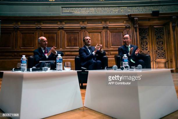 Former UN SecretaryGeneral Ban Kimoon French President Emmanuel Macron and former French Foreign Minister Laurent Fabius attend the World Environment...