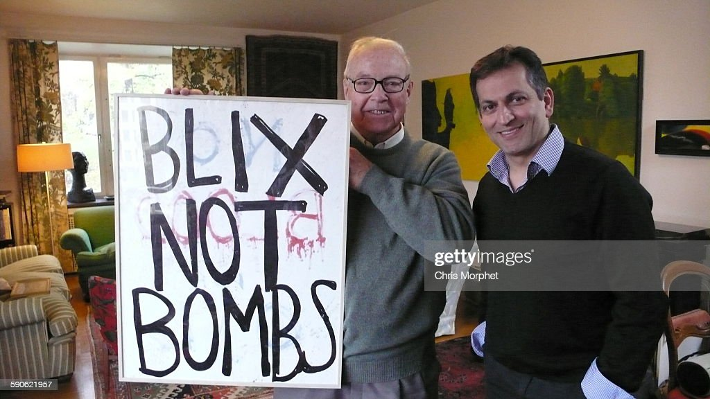 Former UN weapons inspector <a gi-track='captionPersonalityLinkClicked' href=/galleries/search?phrase=Hans+Blix&family=editorial&specificpeople=215493 ng-click='$event.stopPropagation()'>Hans Blix</a> (left) with film director Amir Amirani, holding a placard found after an anti-war demo in New York, pictured in Stockholm, Sweden, 23rd October 2013. The picture was taken after an interview for the documentary 'We Are Many', directed by Amirani.