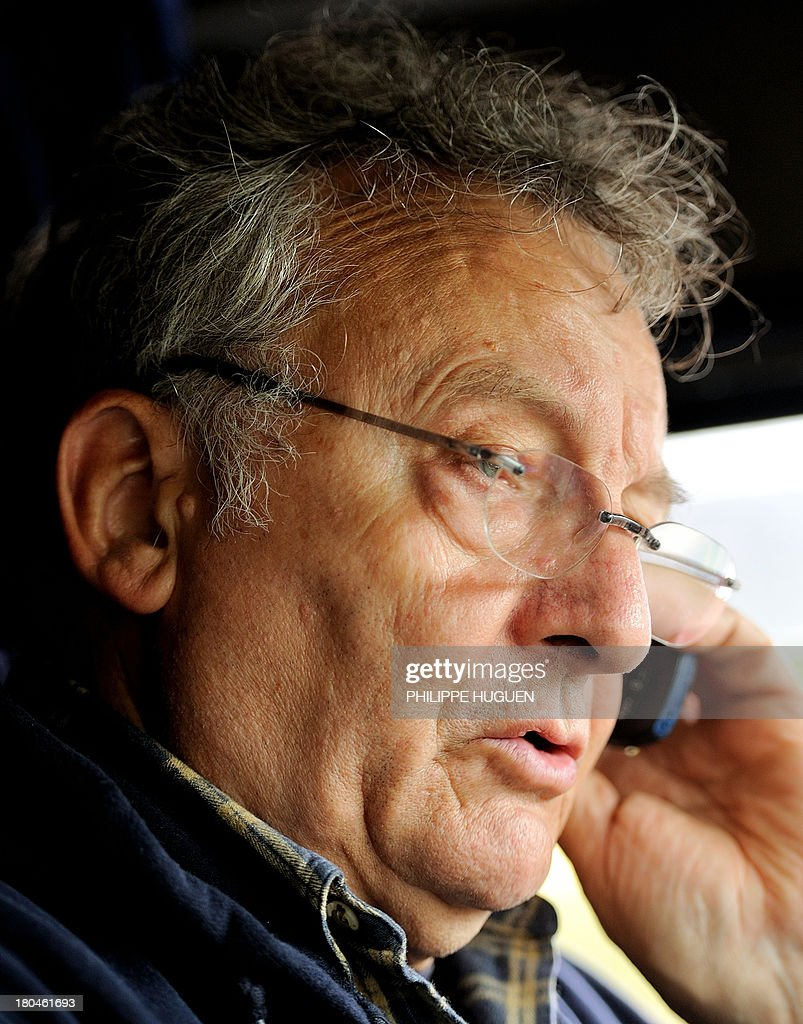 Former undercover French customs officer Marc Fievet talks on the phone in his truck on September 11, 2013 in Barlin, northern France. As a French customs agent, Fievet had infiltrated drug trafficking organizations and while on duty was sentenced to eleven years of emprisonment in Canada. The film 'Gibraltar' directed by Julien Leclercq is based on his autobiographic novel, 'L'Aviseur', about his life as an informer for the customs in Gibraltar. Fievet, nearly 69, is currently working as a truck driver because he doesn't benefit any retirement pensions. He appealed after being dismissed in the first instance last April, following an action to determine the responsibility of the French State. AFP PHOTO PHILIPPE HUGUEN