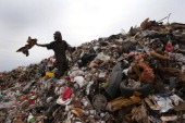 A former undocumented immigrant who was deported from the United States sorts recyclables at the Tirabichi garbage dump on March 5 2013 in Nogales...