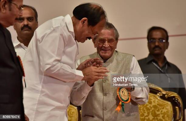 Former Union Minister M V Rajshekaran greets elected Vice President M Venkaiah Naidu during a felicitation ceremony on August 6 2017 in Bengaluru...