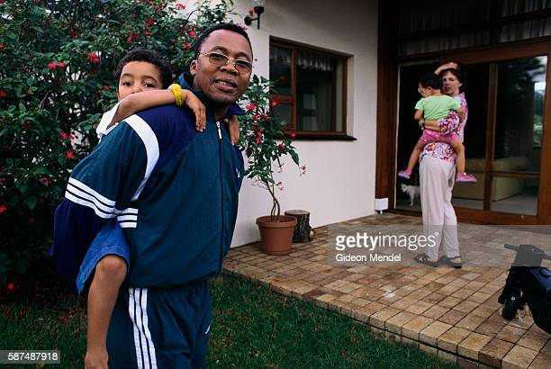 Former United Democratic Front activist Mkhuseli Jack stands with is wife and children in his family's backyard in South Africa Jack became an...