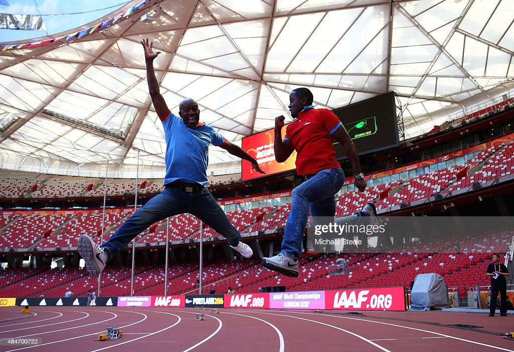 Former United States athletes Allen Johnson (L) and Dwight Phillips jump in the air during a photo opportunity ahead of the 15th IAAF World Athletics Championships Beijing 2015 at the Beijing National Stadium on August 21, 2015 in Beijing, China.