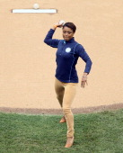 Former United States Olympic gymnast Dominique Dawes throws out the ceremonial first pitch before the New York Mets play against the Arizona...