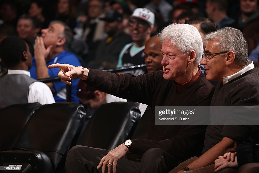 Former United States President <a gi-track='captionPersonalityLinkClicked' href=/galleries/search?phrase=Bill+Clinton&family=editorial&specificpeople=67203 ng-click='$event.stopPropagation()'>Bill Clinton</a> attends a game between the Oklahoma City Thunder and the Brooklyn Nets at the Barclays Center on January 31, 2014 in the Brooklyn borough of New York City.