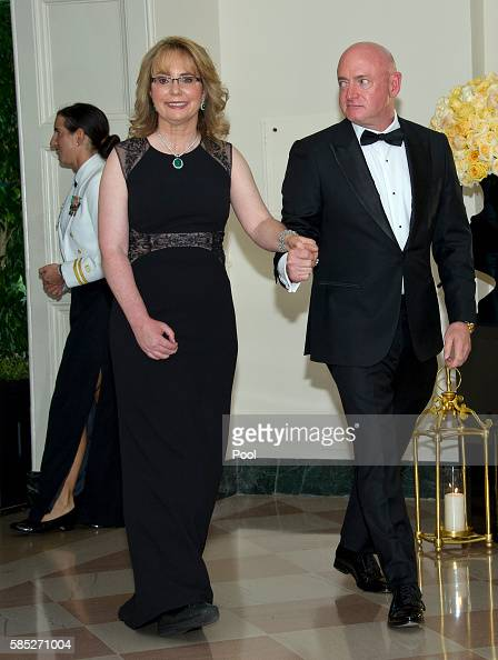 Former United States Representative Gabrielle Giffords and Captain Mark Kelly arrive at the White House August 2 2016 in Washington DC President...