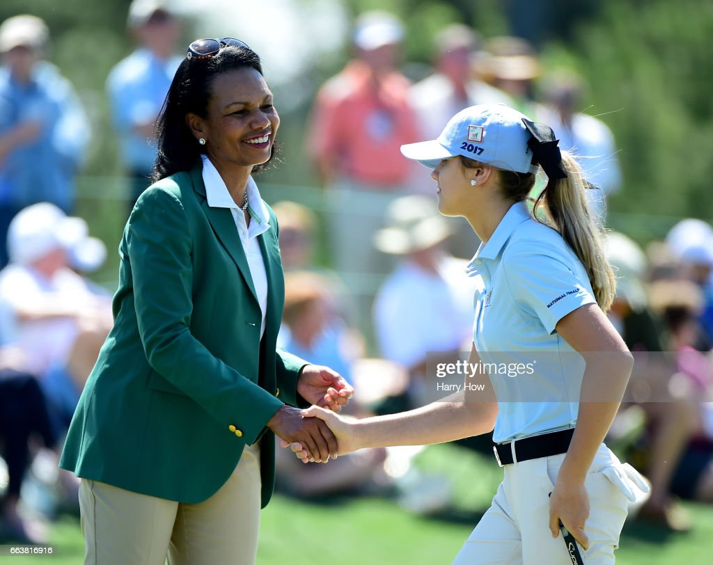 Former United States Secretary of State Condoleezza Rice, shakes hands with Karson Adkins during the Drive, Chip and Putt Championship at Augusta National Golf Club on April 2, 2017 in Augusta, Georgia.