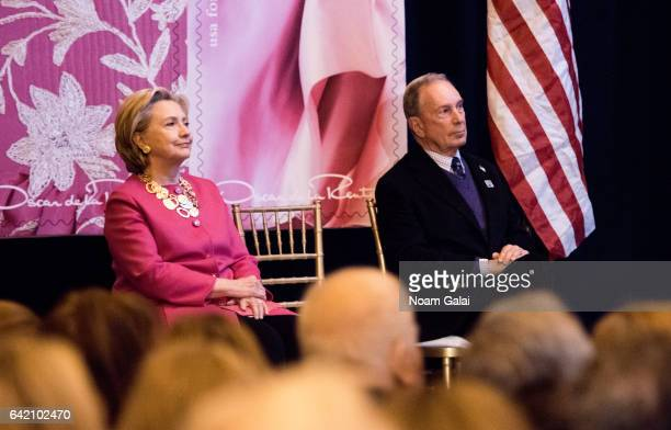 Former United States Secretary of State Hillary Clinton and Michael Bloomberg attend the Oscar de la Renta Forever Stamp dedication ceremony at Grand...