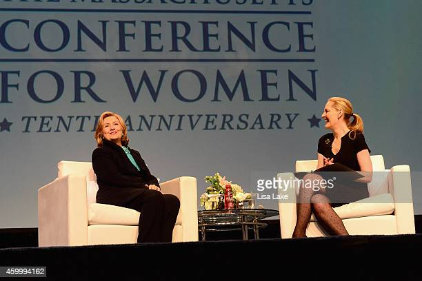Former United States Secretary of State Hillary Rodham Clinton speaks on stage at the 2014 Massachusetts Conference for Women at Boston Convention...