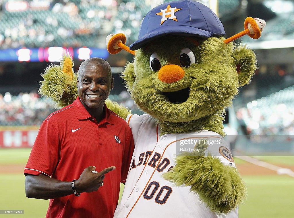 Former University of Houston track star and gold olympic medalist Carl Lewis with Houston Astros mascot Orbit at Minute Maid Park on August 6, 2013 in Houston, Texas.