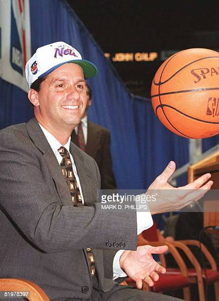 Former University of Massachusetts basketball coach John Calipari tosses a basketball as he meets the media at the Meadowlands Arena for a press...