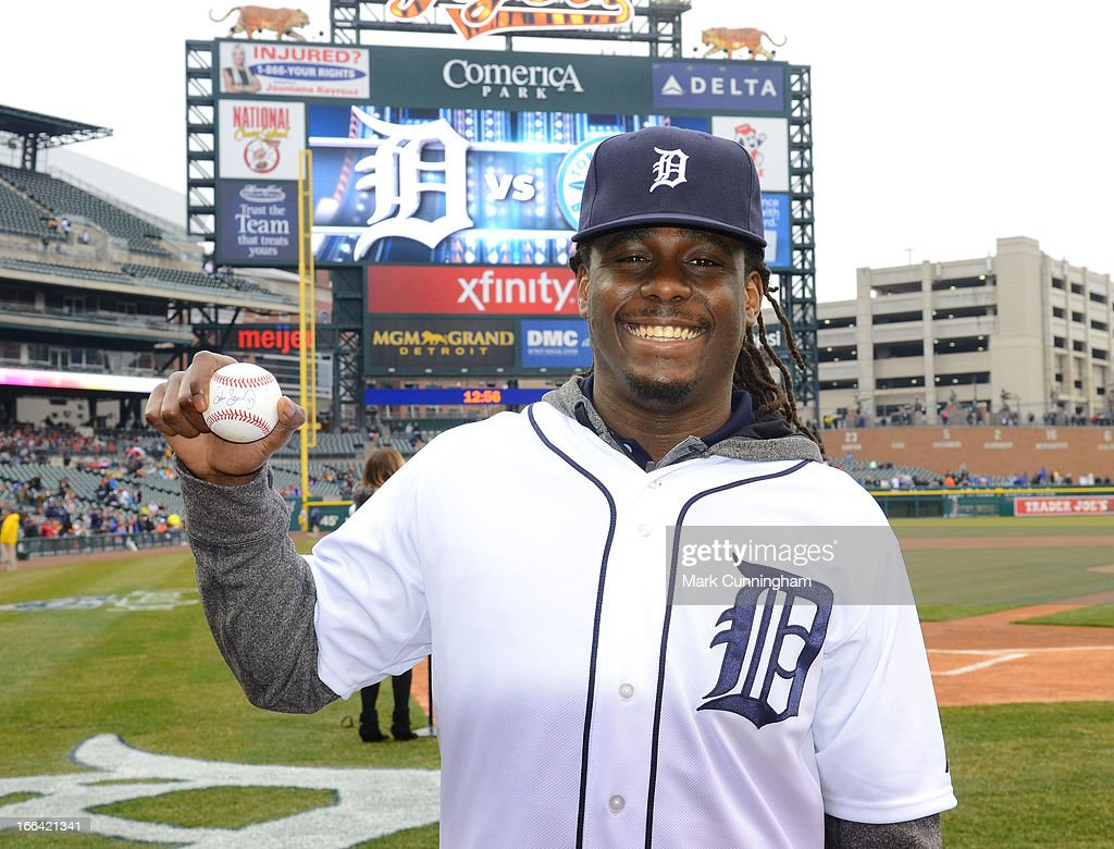 Former University of Michigan quarterback Denard Robinson poses for a photo after throwing out the ceremonial first pitch prior to the start of the game between the Toronto Blue Jays and the Detroit Tigers at Comerica Park on April 9, 2013 in Detroit, Michigan. The Tigers defeated the Blue Jays 7-3.