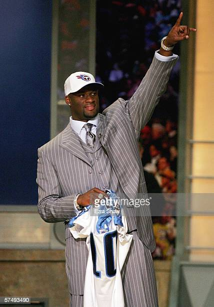 Former University of Texas quarterback Vince Young points into the audience after being selected by the Tennessee Titans as the third overall pick in...