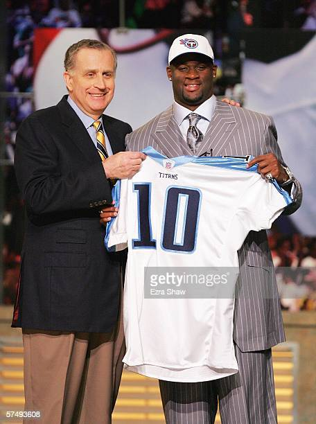 Former University of Texas quarterback Vince Young poses with NFL Commissioner Paul Tagliabue after being selected by the Tennessee Titans as the...