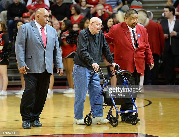 Former UNLV head basketball coach Jerry Tarkanian is escorted to his courtside seat by head security supervisor Eli Cordeiro and usher Ronnie Luneza...
