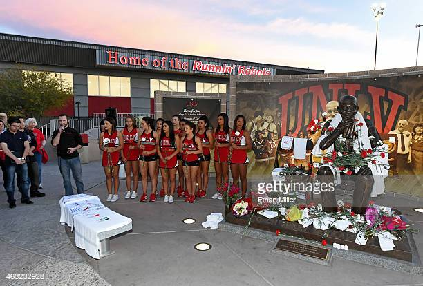 Former UNLV Rebels mascot Jon 'Jersey' Goldman speaks as UNLV Rebels cheerleaders and dance team members hold carnations at a statue of Jerry...