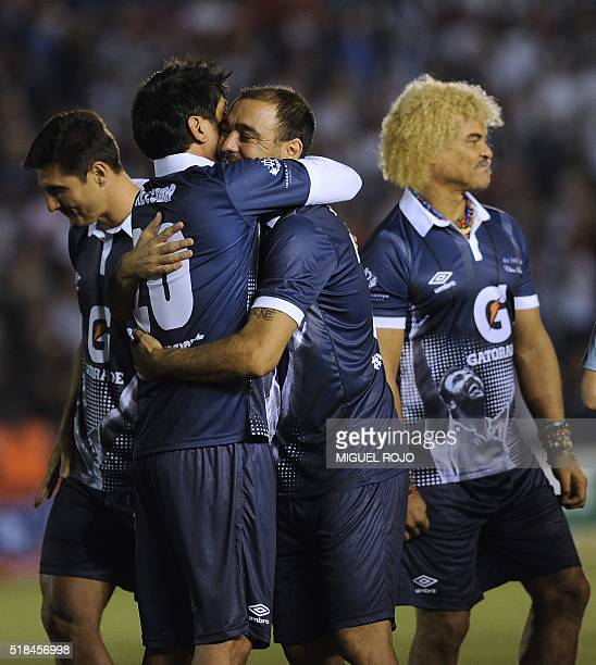 Former Uruguayan football player Alvaro Recoba is hugged by Argentinian player Roman Riquelme next to Argentinian Javier Zanetti and Colombian Carlos...