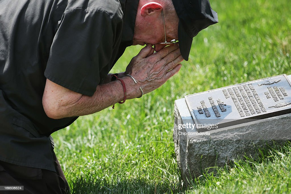 Former U.S. Agency for International Development employee Michael Benge kneels and offers a prayer at the plaque dedicated to the U.S. Secret Army in the Kingdom of Laos during a memorial and wreath-laying ceremony at Arlington National Cemetery May 10, 2013 in Arlington, Virginia. Supported by the United States and the Central Intelligence Agency from 1961 to 1973, the secret army of Hmong and Lao combat soldiers fought in the jungles of Southeast Asia during the Vietnam War. Benge was held by the North Vietnamese Army as a prisoner of war from 1968 to 1973, enduring disease, starvation and watching his friends and fellow prisoners die.