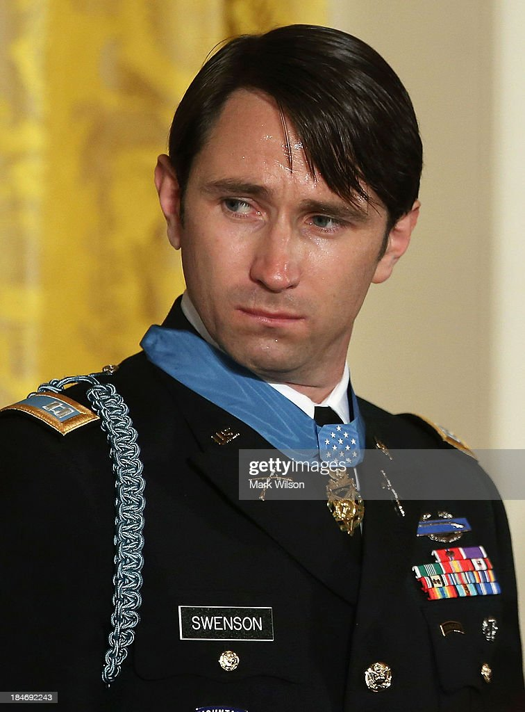 Former U.S. Army Captain William Swenson wears the Medal of Honor giving to him by President Barack Obama during a ceremony in the East Room of the White House October 15, 2013 in Washington, DC. Honored for his actions in the 2009 Battle of Ganjgal Valley in the Kunar Province of Afghanistan, Swenson is the sixth living veteran of the Iraq and Afghanistan wars to receive the Medal of Honor, awarded to a person who 'distinguished himself conspicuously by gallantry and intrepidity at the risk of his life above and beyond the call of duty.'