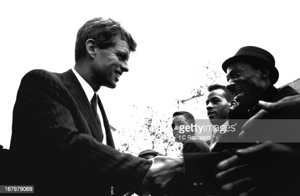 Former US Attorney General Bobby Kennedy shakes hands with potential voters on 125th Street in Harlem during his run for the US Senate seat for NY in...
