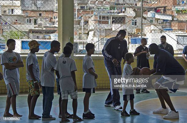 Former US basketball player and NBA ambassador Horace Grant and Brazilian NBA's Washington Wizards player Nene teach children of the Alemao favela...