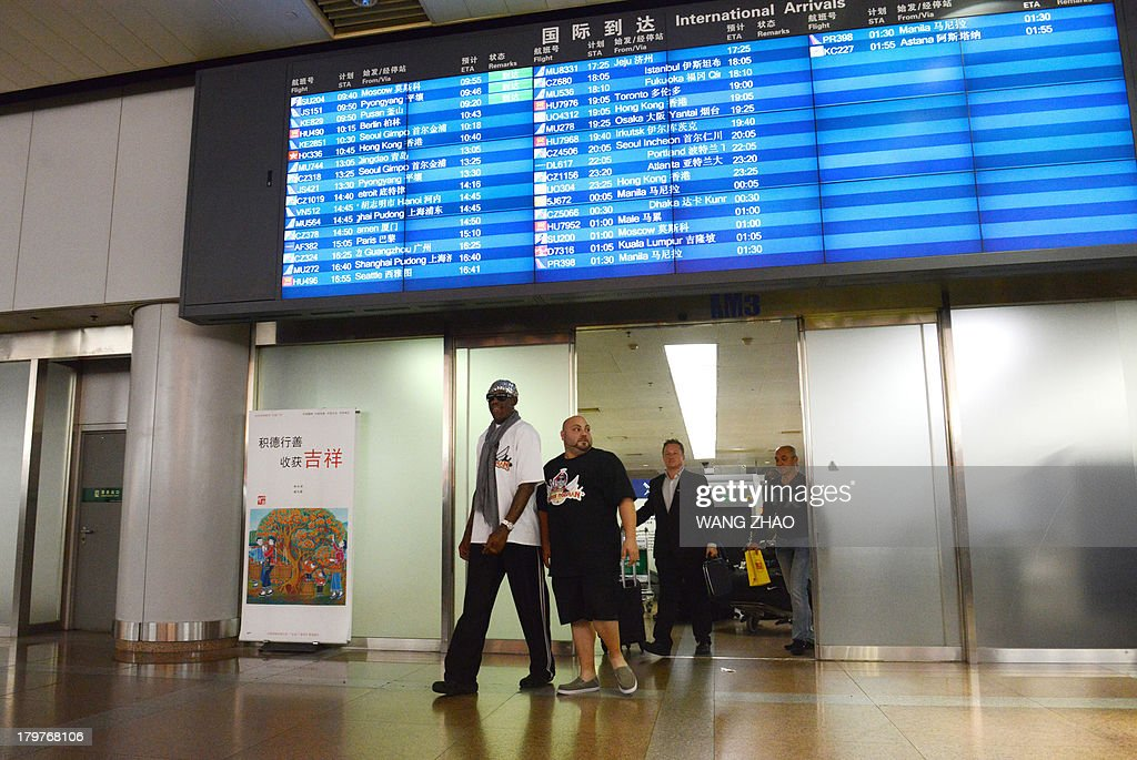Former US basketball player Dennis Rodman arrives at Beijing International Airport from North Korea on September 7, 2013. Rodman returned to China from Pyongyang on September 7 after a five-day trip when he met North Korean leader Kim Jong-Un, but without jailed American Kenneth Bae.