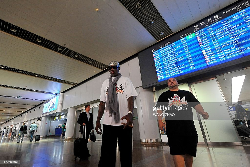 Former US basketball player Dennis Rodman arrives at Beijing International Airport from North Korea on September 7, 2013. Rodman returned to China from Pyongyang on September 7 after a five-day trip when he met Kim Jong-Un, but without jailed American Kenneth Bae.