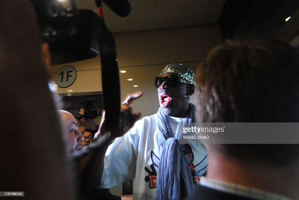 Former US basketball player Dennis Rodman speaks to members of the media as he arrives at Beijing International Airport from North Korea on September 7, 2013. Rodman returned to China from Pyongyang on September 7 after a five-day trip when he met North Korean leader Kim Jong-Un, but without jailed American Kenneth Bae. AFP PHOTO / WANG ZHAO