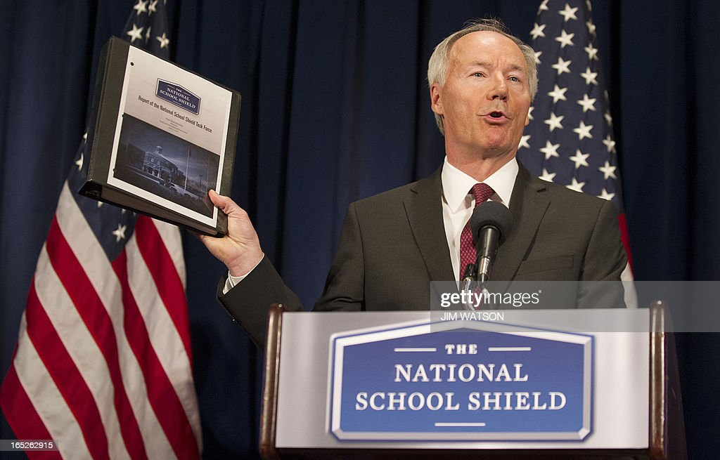 Former US Congressman Asa Hutchinson announces the findings and recommendations of the National School Shield Program at the National Press Club in Washington, DC, April 2, 2013. The NRA-backed National School Shield program on Tuesday unveiled recommendations to protect schools from instances of violence, including a model program to train and enable school personnel to carry firearms. Hutchinson was tasked by the National Rifle Association following the December shooting at an elementary school in Newtown, Connecticut to develop the recommendations to bolster school security. AFP PHOTO/Jim WATSON