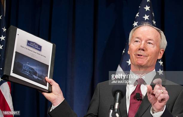 Former US Congressman Asa Hutchinson announces the findings and recommendations of the National School Shield Program at the National Press Club in...