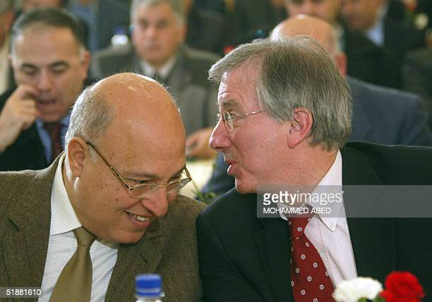 Former US envoy to the Middle East Dennis Ross talks to Palestinian foreign minister Nabil Shaath in Gaza City 20 December 2004 Attending a peace...
