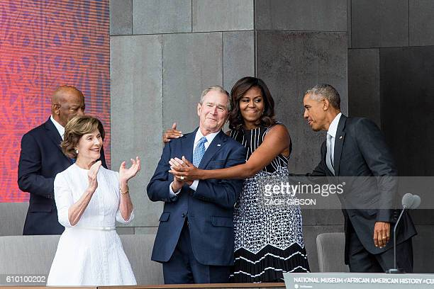 TOPSHOT Former US First Lady Laura Bush former US President George W Bush First Lady Michelle Obama and President Barack Obama attend the opening...
