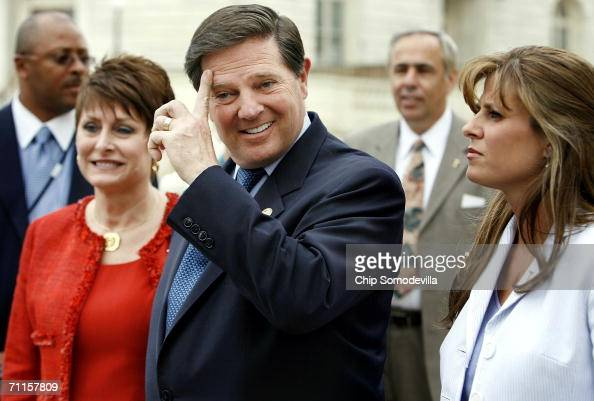 Former US House of Representatives majority leader Tom Delay walks with his daughter Danielle Ferro and his wife Christine Delay from the Cannon...