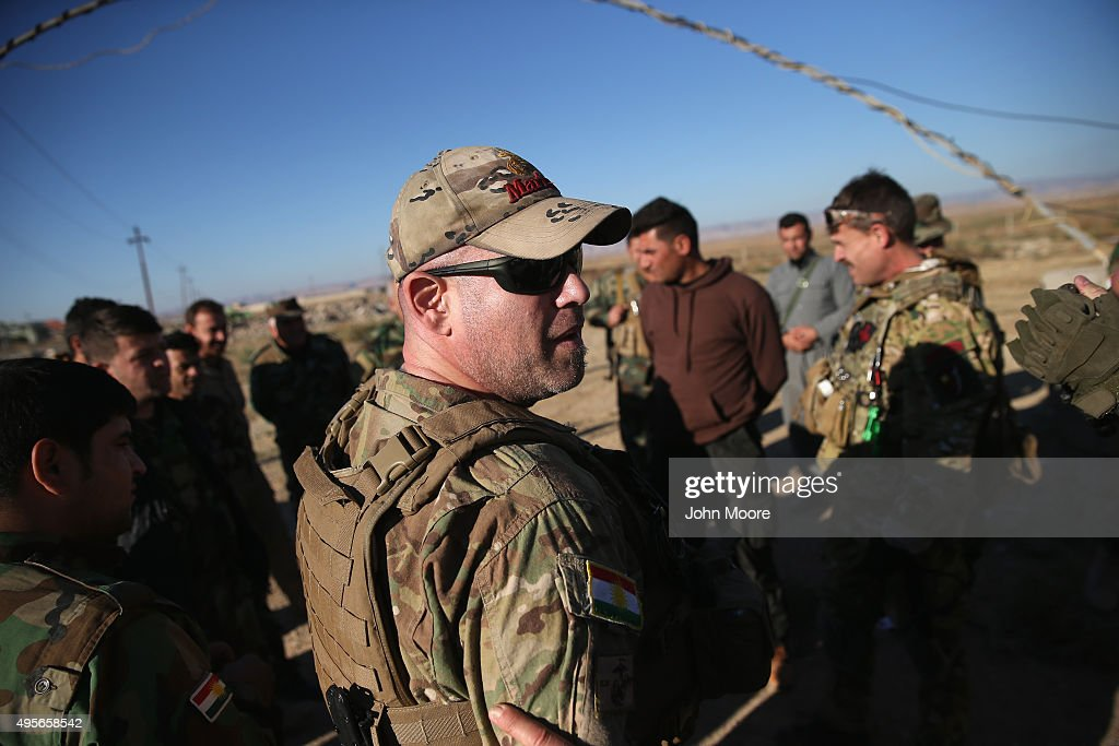 Former US Marine and member of the International Peshmerga Volunteers Justin Garfield instructs Iraqi Peshmerga troops on battlefield medical...