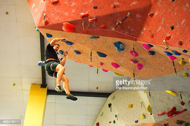 Former US Marine Captain Billy Birdzell reacts during a rock climbing maneuver at the Earth Treks Climbing Center in Rockville Maryland on March 8...