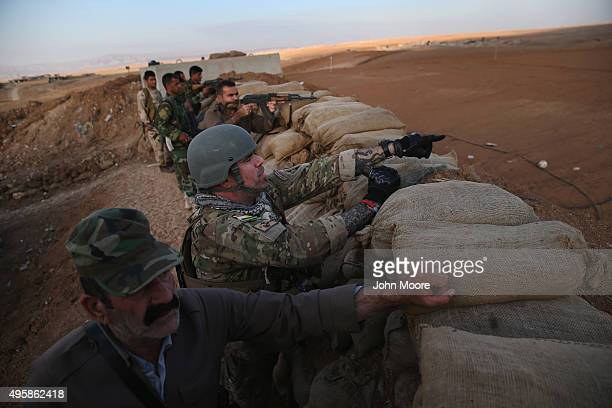 Former US Marine Justin Garfield one of a group called the International Peshmerga Volunteers stands with Kurdish Peshmerga forces on a frontline...