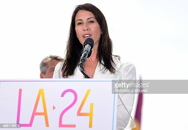 Former US Olympic Swimmer Janet Evans addresses the audience on a stage at the Annenberg Beach House in Santa Monica California on September 1 after...