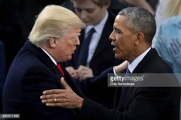 Former US President Barack Obama congratulates US President Donald Trump after he took the oath of office on the West Front of the US Capitol on...