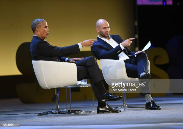 Former US President Barack Obama speaks with Sam Kass during the SeedsChips Global Food Innovation Summit on May 9 2017 in Milan Italy The summit...