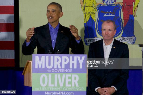 Former US President Barack Obama walks on stage in support of Democratic candidate Phil Murphy who is running against Republican Lt Gov Kim Guadagno...