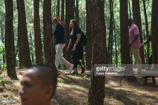 Former US President Barack Obama walks with a staff during his visit to Becici Pine Forest on June 29 2017 in Yogyakarta Indonesia Obama and his...