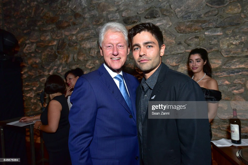 Former U.S. President Bill Clinton and Adrian Grenier attend the Oceana New York Gala at Blue Hill at Stone Barns on September 13, 2017 in Tarrytown, New York.