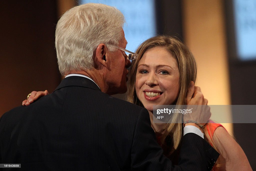 Former US President Bill Clinton and daughter Chelsea Clinton attend the Closing Plenary Session of the Clinton Global Initiative (CGI) September 26, 2013 in New York. AFP PHOTO/Mehdi Taamallah