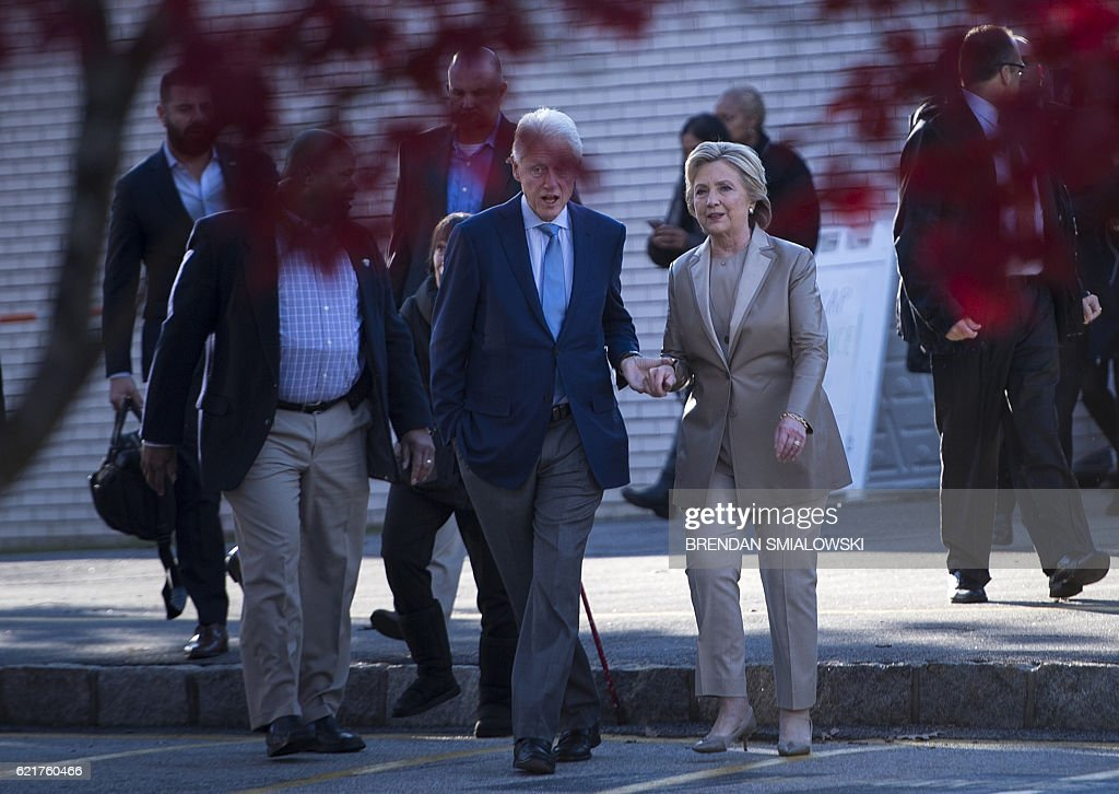 Former US President Bill Clinton and Democratic presidential nominee Hillary Clinton leave after voting at Douglas G. Griffin School November 8, 2016 in Chappaqua, New York. Chanting 'Madam President,' about 150 supporters turned out to cheer on the Democratic nominee who voted with husband Bill Clinton at an elementary school near their home in Chappaqua / AFP / Brendan Smialowski