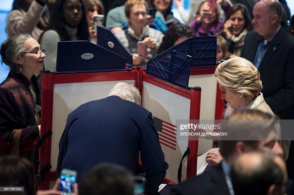 TOPSHOT - Former US President Bill Clinton (L) and Democratic presidential nominee Hillary Clinton (R)vote at Douglas G. Griffin School November 8, 2016 in Chappaqua, New York. / AFP / Brendan Smialowski