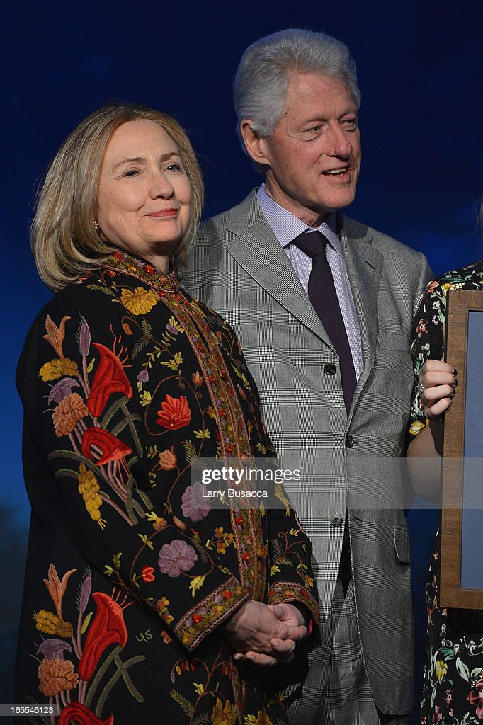 Former US President Bill Clinton and Former US Secretary of State Hillary Clinton attend SeriousFun Children's Network event honoring Liz Robbins with celebrity guests at Pier Sixty at Chelsea Piers on April 4, 2013 in New York City.