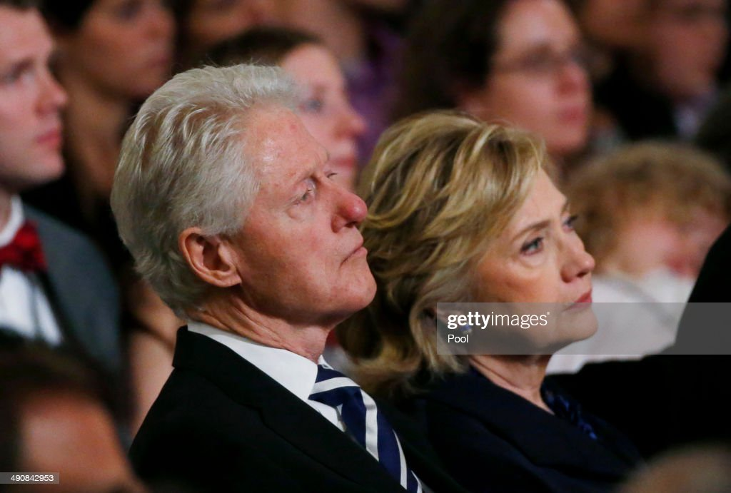 Former U.S. president <a gi-track='captionPersonalityLinkClicked' href=/galleries/search?phrase=Bill+Clinton&family=editorial&specificpeople=67203 ng-click='$event.stopPropagation()'>Bill Clinton</a> and former U.S. Secretary of State <a gi-track='captionPersonalityLinkClicked' href=/galleries/search?phrase=Hillary+Clinton&family=editorial&specificpeople=76480 ng-click='$event.stopPropagation()'>Hillary Clinton</a> attend the opening ceremony for the National September 11 Memorial Museum at ground zero May 15, 2014 in New York City. The museum spans seven stories, mostly underground, and contains artifacts from the attack on the World Trade Center Towers on September 11, 2001 that include the 80 ft high tridents, the so-called 'Ground Zero Cross,' the destroyed remains of Company 21's New York Fire Department Engine as well as smaller items such as letter that fell from a hijacked plane and posters of missing loved ones projected onto the wall of the museum. The museum will open to the public on May 21.
