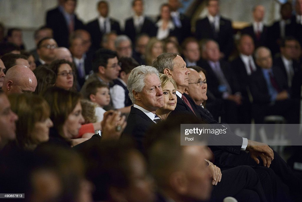 Former U.S. president Bill Clinton and former U.S. Secretary of State Hillary Clinton attend the opening ceremony for the National September 11 Memorial Museum at ground zero May 15, 2014 in New York City. The museum spans seven stories, mostly underground, and contains artifacts from the attack on the World Trade Center Towers on September 11, 2001 that include the 80 ft high tridents, the so-called 'Ground Zero Cross,' the destroyed remains of Company 21's New York Fire Department Engine as well as smaller items such as letter that fell from a hijacked plane and posters of missing loved ones projected onto the wall of the museum. The museum will open to the public on May 21.